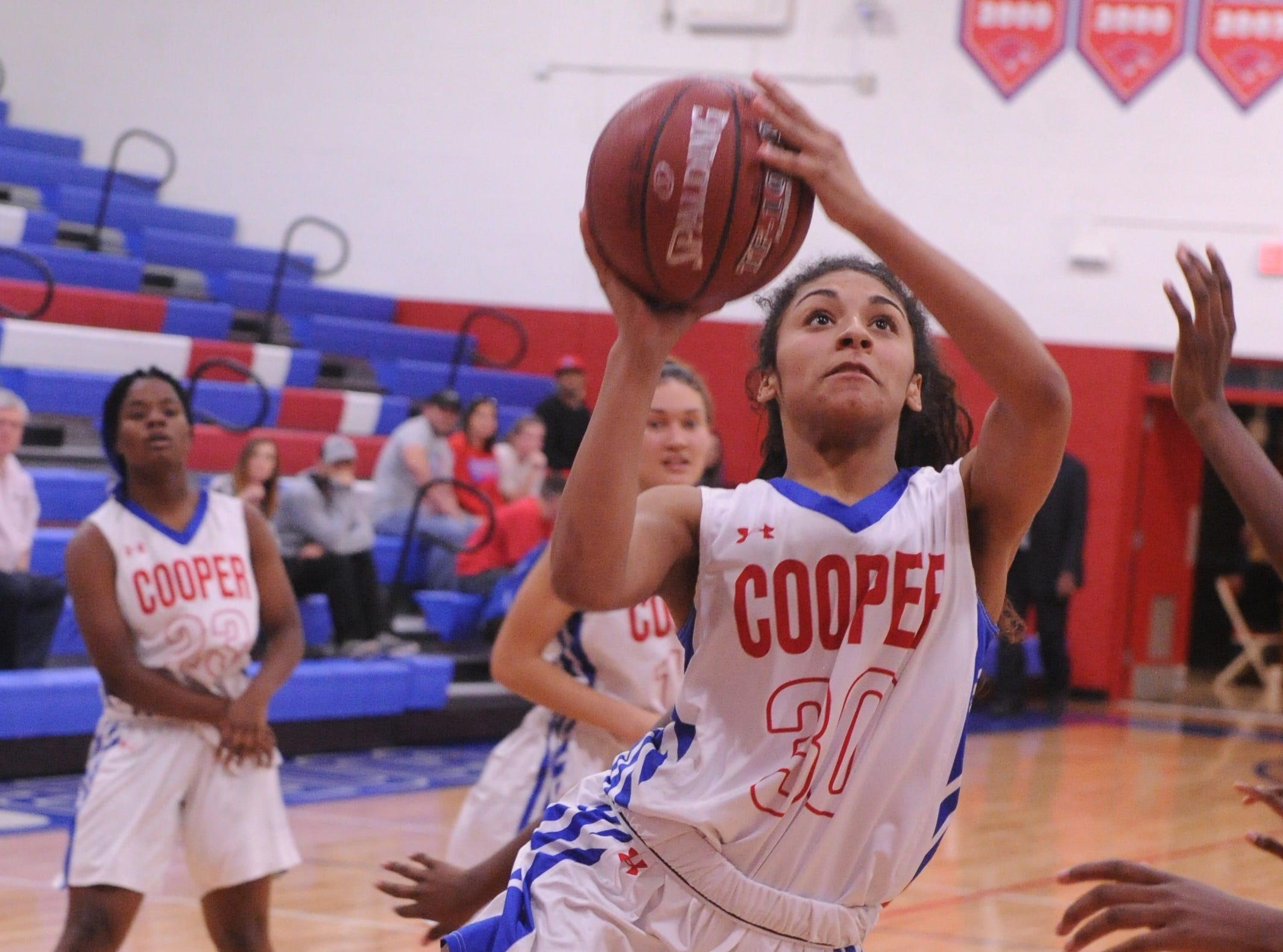 Cooper's Keiana Kemp drives to the basket against the Wichita Falls Hirschi defense. Hirschi won the game 51-37 in the season opener for both teams Tuesday, Nov. 6, 2018, at Cougar Gym.