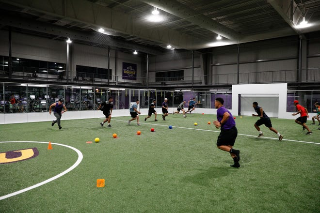 Hardin Simmons students and a few of their friends rush toward the center of the indoor soccer field that served as a dodgeball court for an event held by the school's Faith & Fitness club.  Club sponsor Bob Moore said the group's focus is on encouraging students to work on both their spiritual and physical health.
