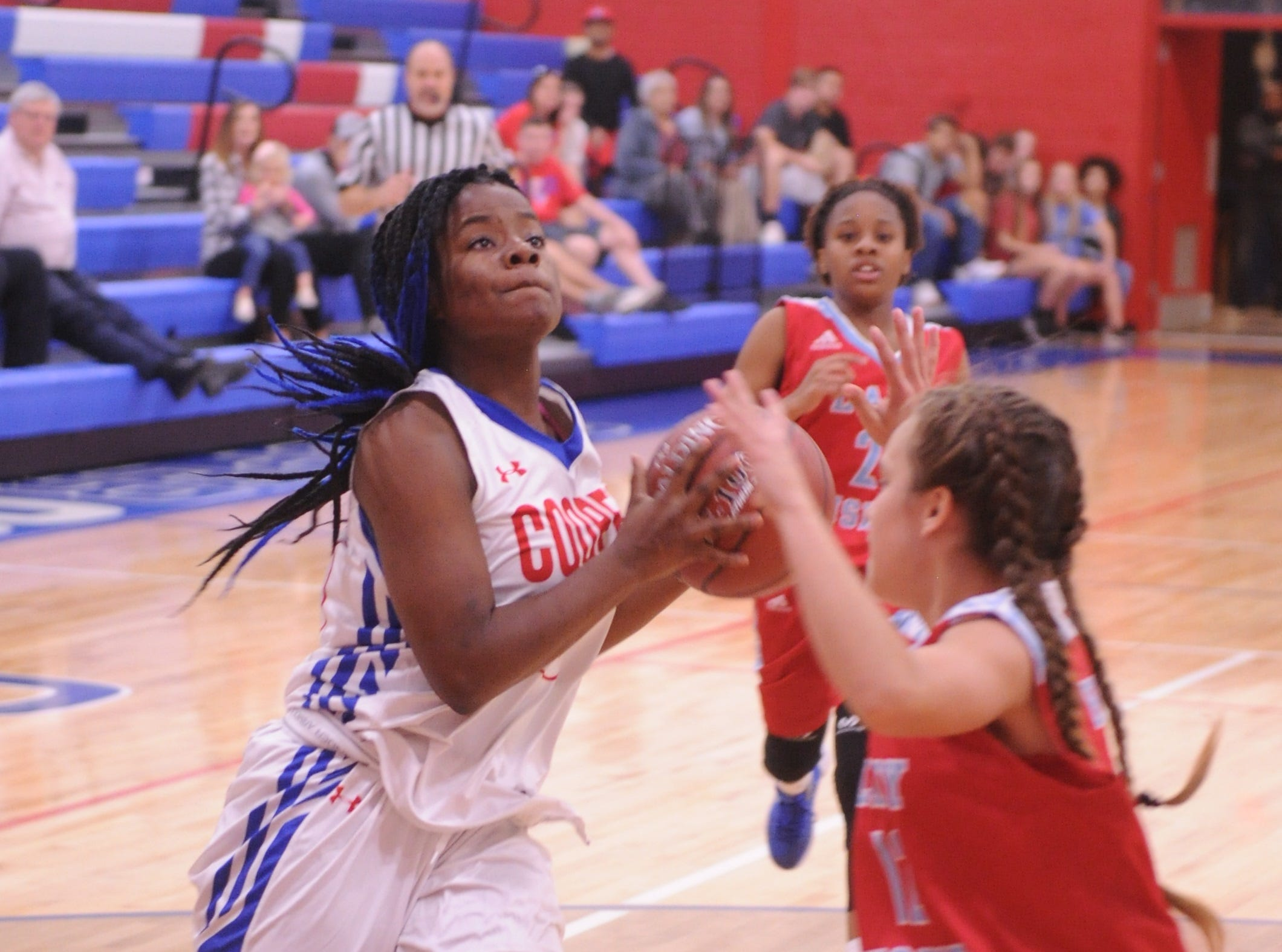 Cooper's Dazz Larkins, left, drives to the basket against a Wichita Falls Hirschi defender. Hirschi won the game 51-37 in the season opener for both teams Tuesday, Nov. 6, 2018, at Cougar Gym.