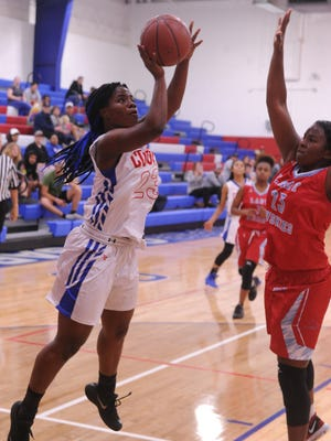Cooper's Dazz Larkins, left, shoots over Wichita Falls Hirschi's Tae Smith. She scored eight points in the game and scored a team-high 16 points against Snyder on Friday.