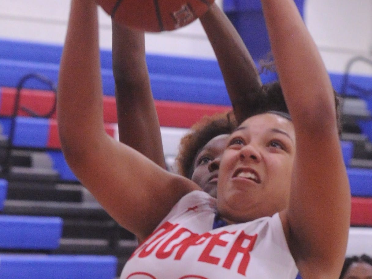 Cooper's Jennika Willis grabs a rebound as a Wichita Falls Hirschi player defends from behind. Hirschi won the game 51-37 in the season opener for both teams Tuesday, Nov. 6, 2018, at Cougar Gym.