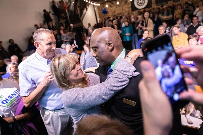 Quentin Miller, newly elected Buncombe County sheriff, is embraced by Suzy Morrissey, the Democratic cluster leader for south Buncombe, at the Democratic Party election night party at Highland Brewing Nov. 6, 2018.