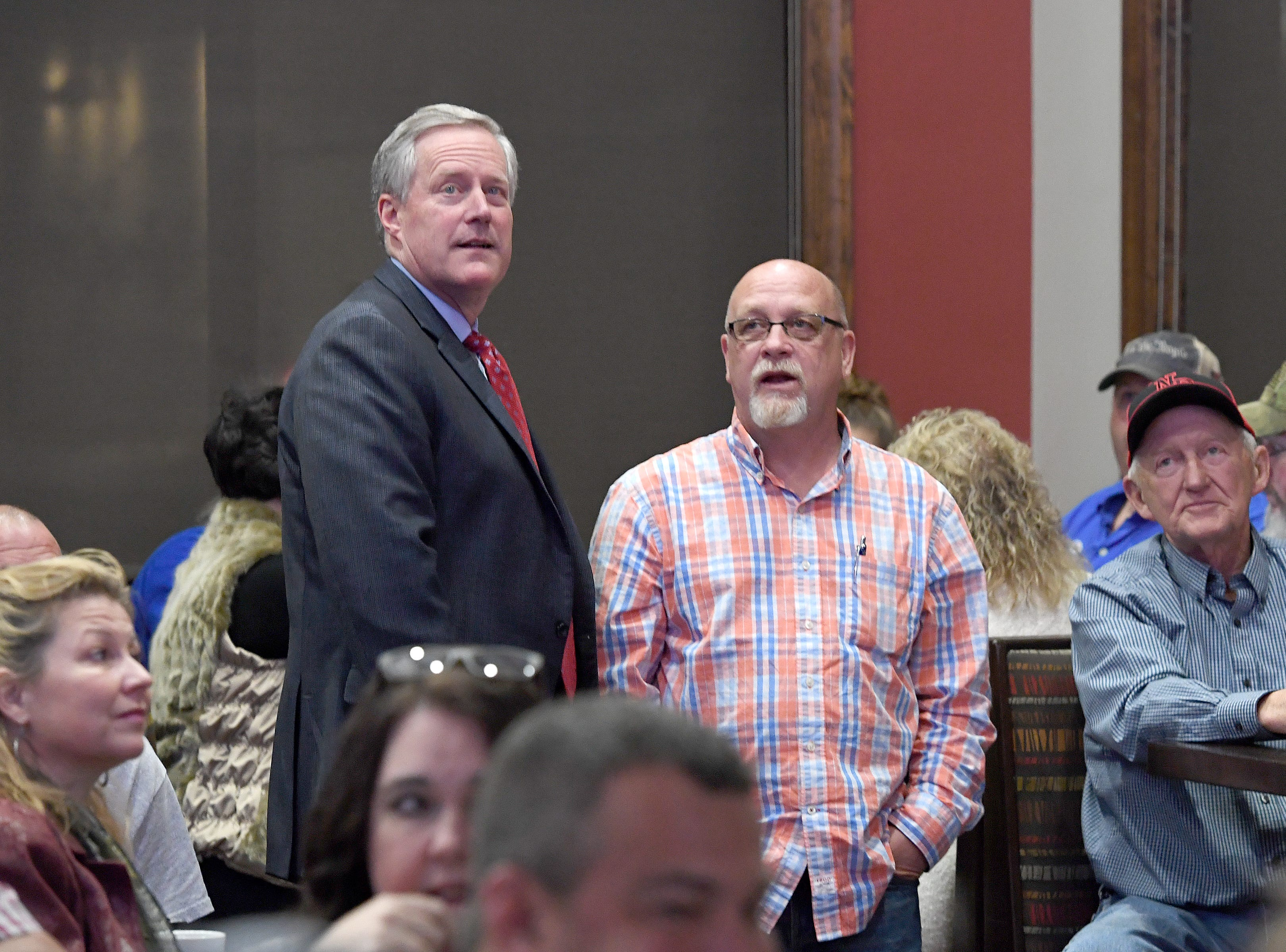 U.S. Representative Mark Meadows watches results being reported on a television with voters during an election results watch party for the Buncombe County Republicans at Twisted Laurel on Nov. 6, 2018.