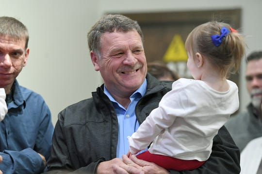 Robert Pressley, Republican incumbent for the Buncombe County Board of Commissioners in District 3, plays with his granddaughter, Elleni, 2, as election results roll in during a watch party for county Republicans at Twisted Laurel on Nov. 6, 2018.