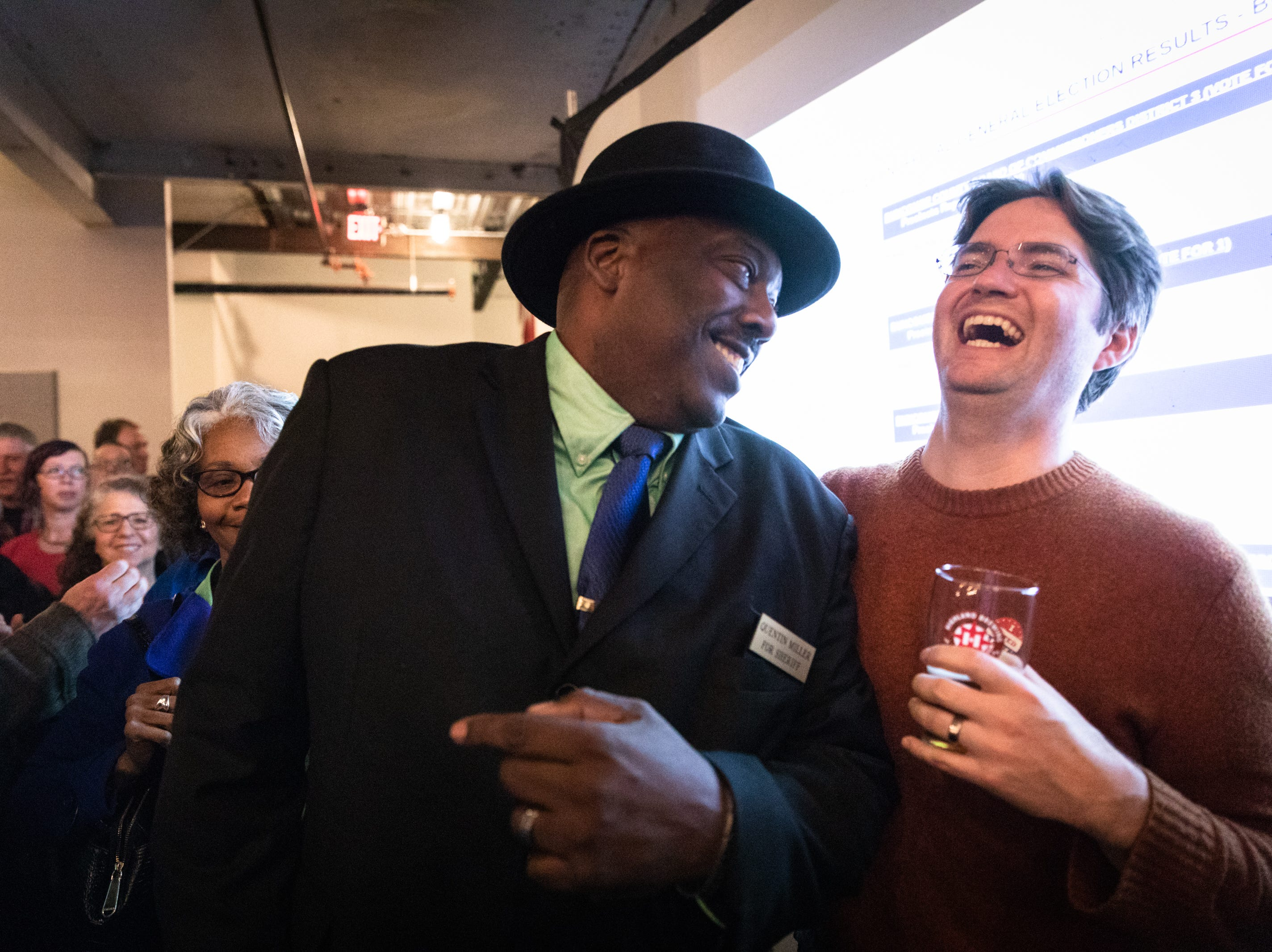 Quentin Miller, newly elected Buncombe County sheriff, is greeted by supporters as he enters the Democratic Party election night party at Highland Brewing Nov. 6, 2018.