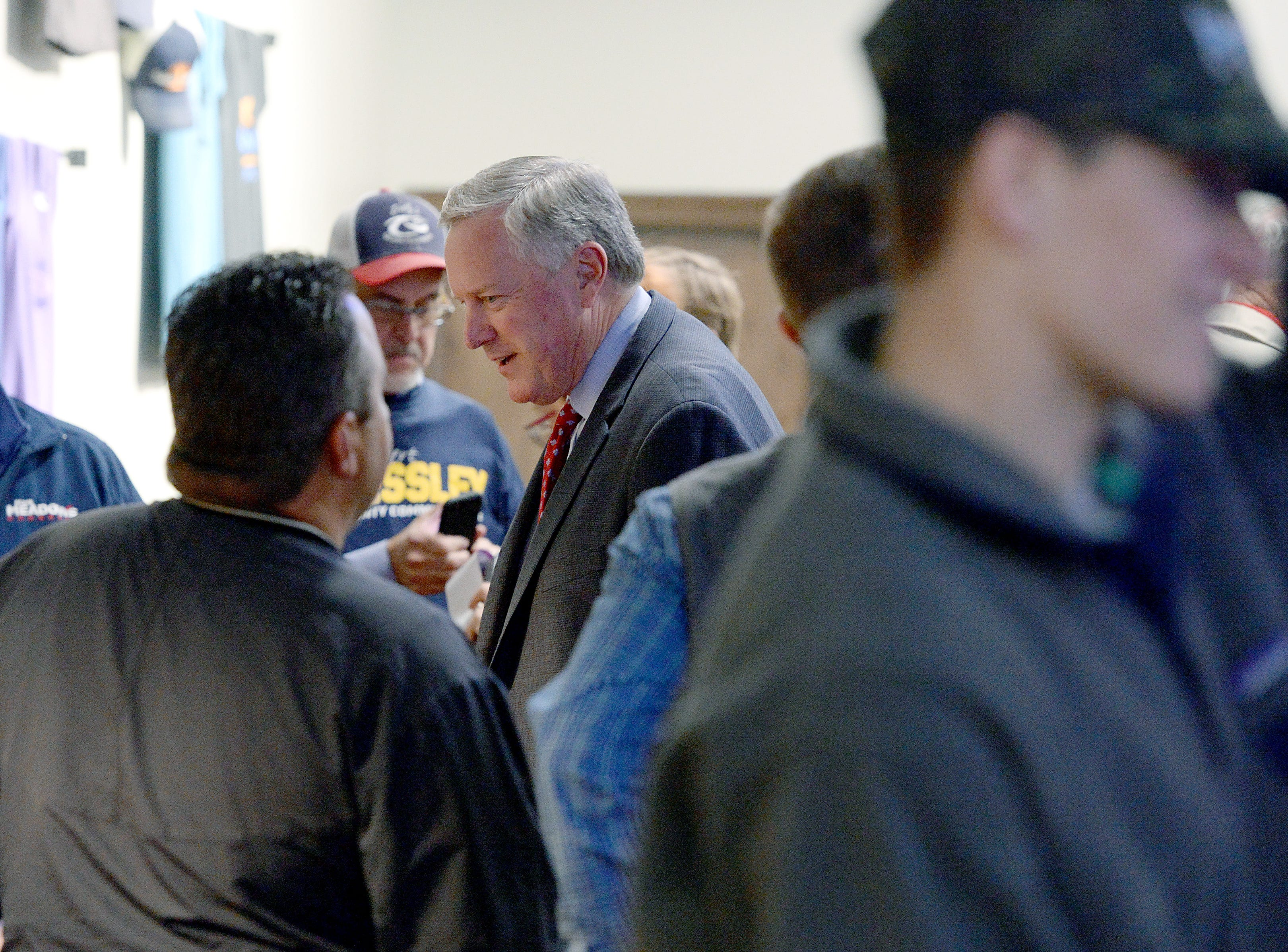 U.S. Representative for District 11 Mark Meadows talks with Buncombe County Sheriff candidate Shad Higgins and other supporters at an election results watch party for the Buncombe County Republicans at Twisted Laurel on Nov. 6, 2018.