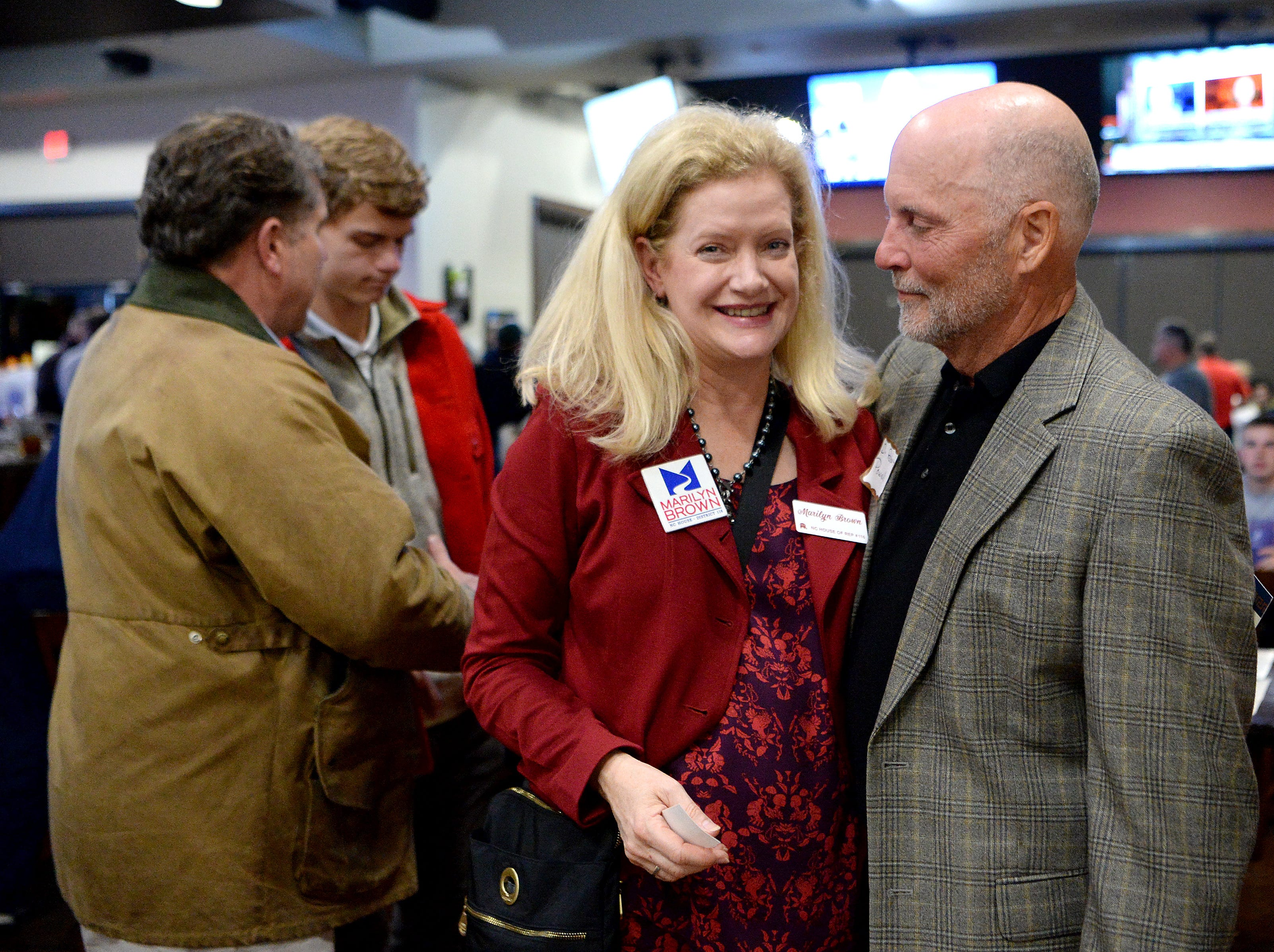 Marilyn Brown, North Carolina House of Representatives Republican candidate for District 116, talks with Robert Powell during an election results watch party for the Buncombe County Republicans at Twisted Laurel on Nov. 6, 2018.