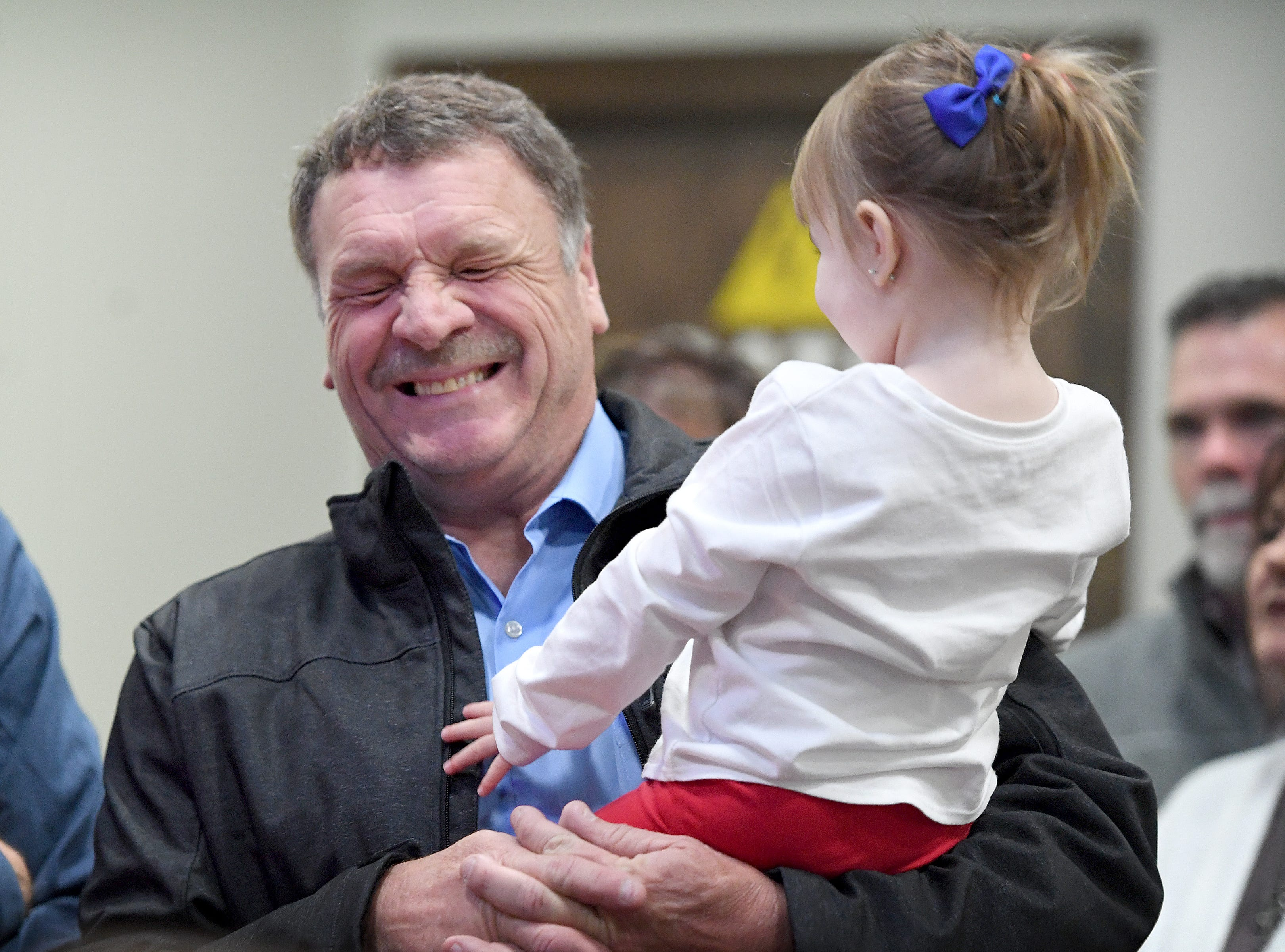 Robert Pressley, Republican Incumbent for County Commission in District 3, plays with his granddaughter, Elleni, 2, as election results roll in during an election results watch party for the Buncombe County Republicans at Twisted Laurel on Nov. 6, 2018.