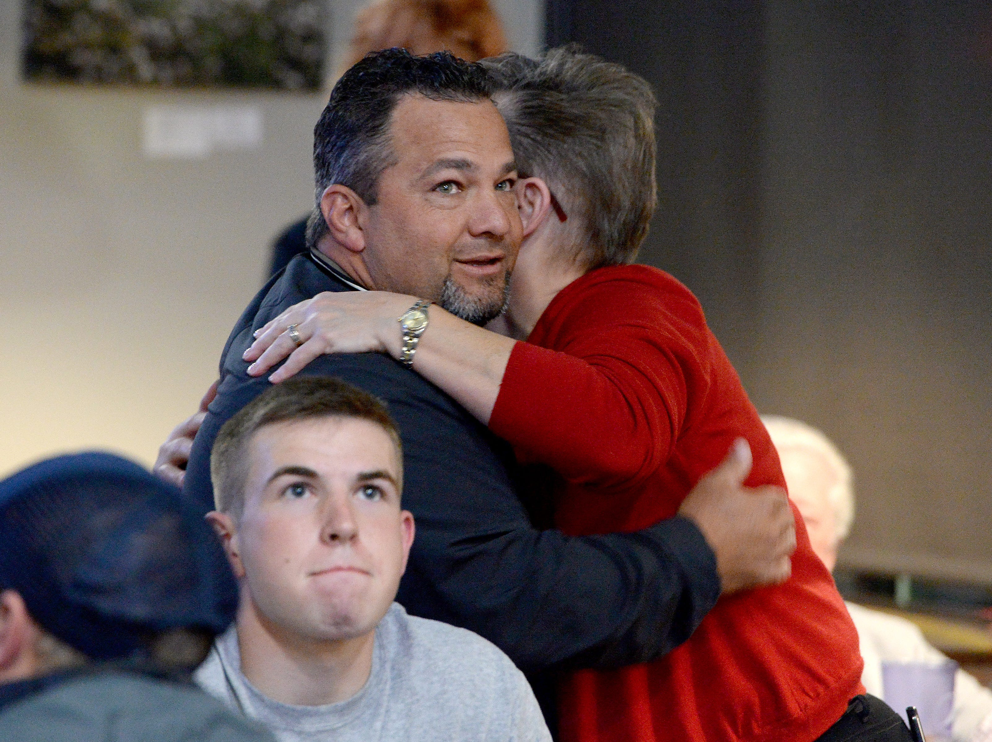 Republican candidate for Buncombe County Sheriff Shad Higgins hugs Glenda Weinert as they wait for results to roll in during an election results watch party for the Buncombe County Republicans at Twisted Laurel on Nov. 6, 2018.