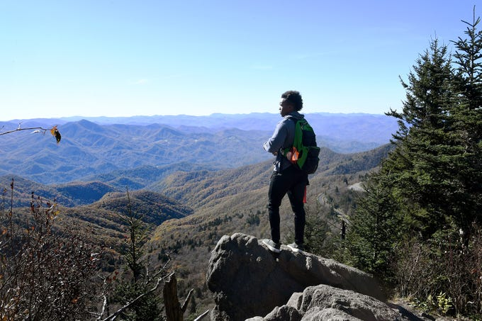 Joshua Perkins takes in the view from the top of Waterrock Knob as he hikes with Pathways to Parks on Oct. 30, 2018. Pathways to Parks is an outdoors group that aims to get more people of color outside and enjoying National Parks.