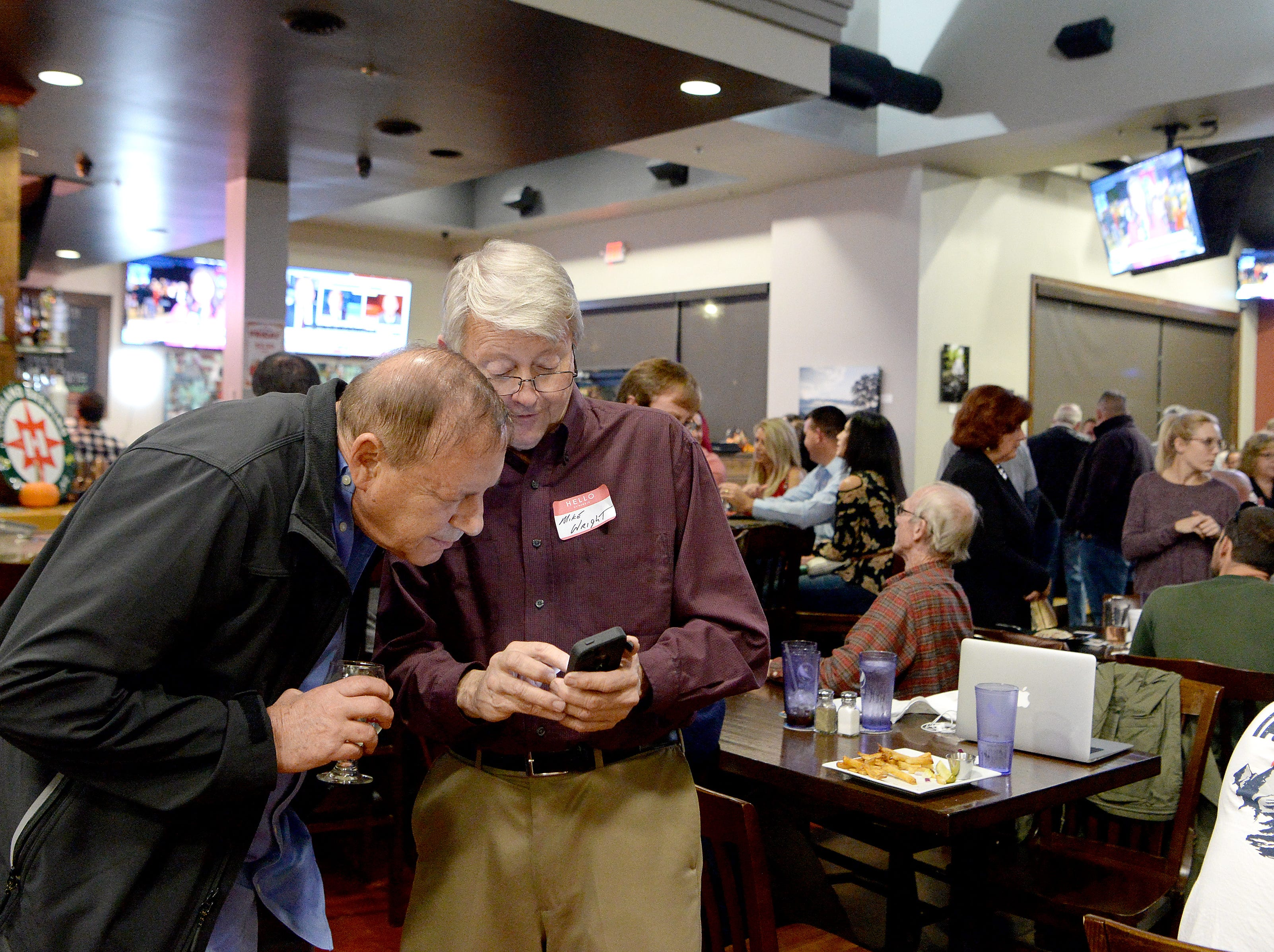 Supporters watch results roll in during an election results watch party for the Buncombe County Republicans at Twisted Laurel on Nov. 6, 2018.