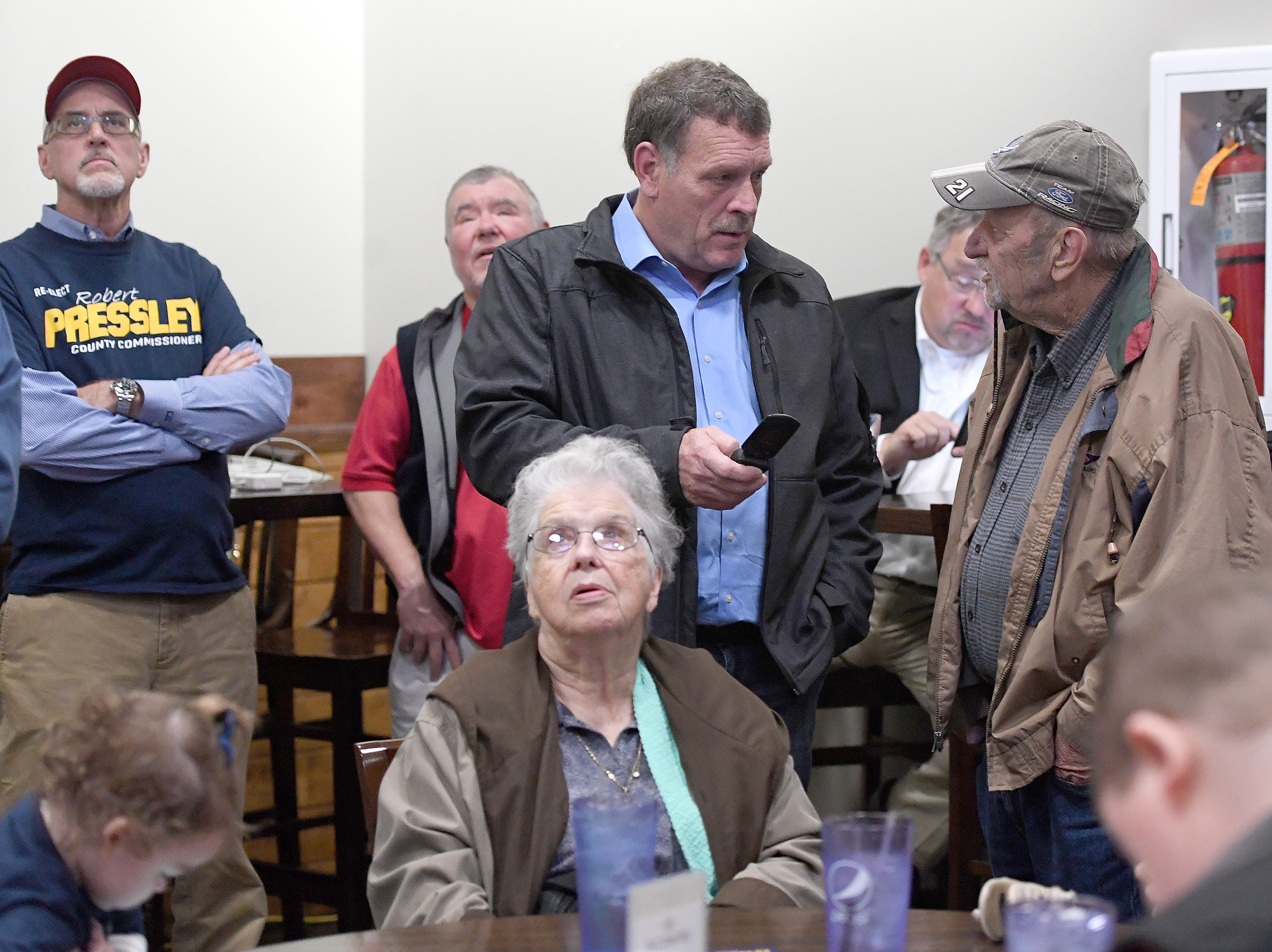 Republican Incumbent for County Commissioner in District 3 Robert Pressley talks with Mike Friar during an election results watch party for the Buncombe County Republicans at Twisted Laurel on Nov. 6, 2018.