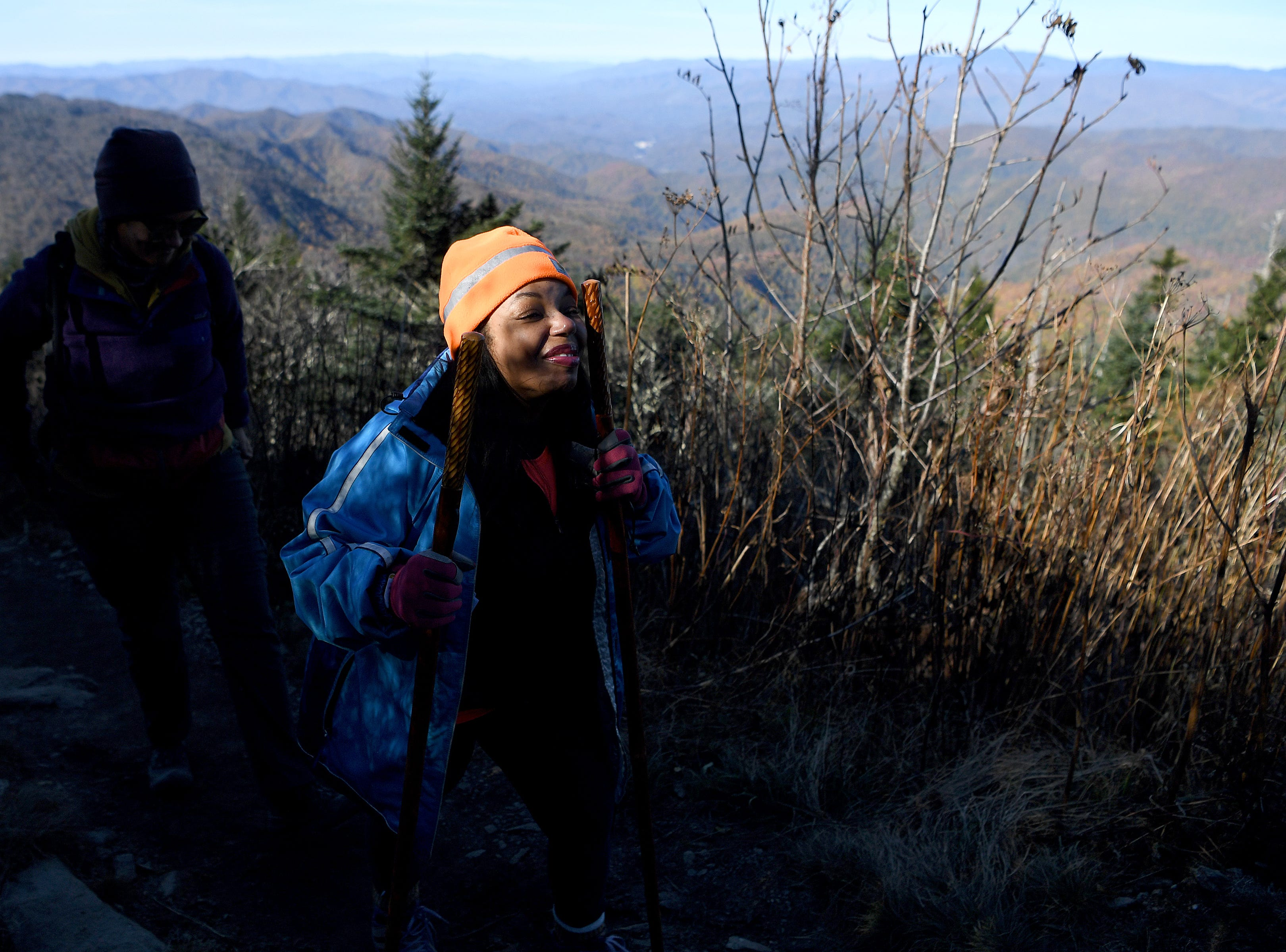 Tanya Cummings smiles as the sunlight hits her face as she hikes up Waterrock Knob with Pathways to Parks on Oct. 30, 2018. Pathways to Parks is an outdoors group that aims to get more people of color outside and enjoying National Parks.