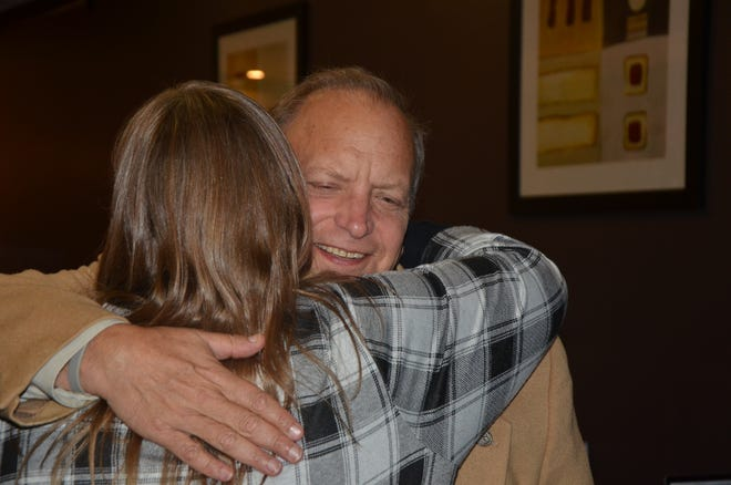 Dr. John Bizon hugs Calhoun County Republicans Chair Jeannie Burchfield at Pache's Seafood Kitchen in Battle Creek on Tuesday, November 6, 2018.