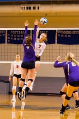Marshall's Olivia Webber goes for the kills during this Division 2 regional semifinal against Fowlerville.