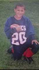 Jeremiah Allen, a, 18-year-old senior halfback on the Chenango Forks football team, at the age of 7.