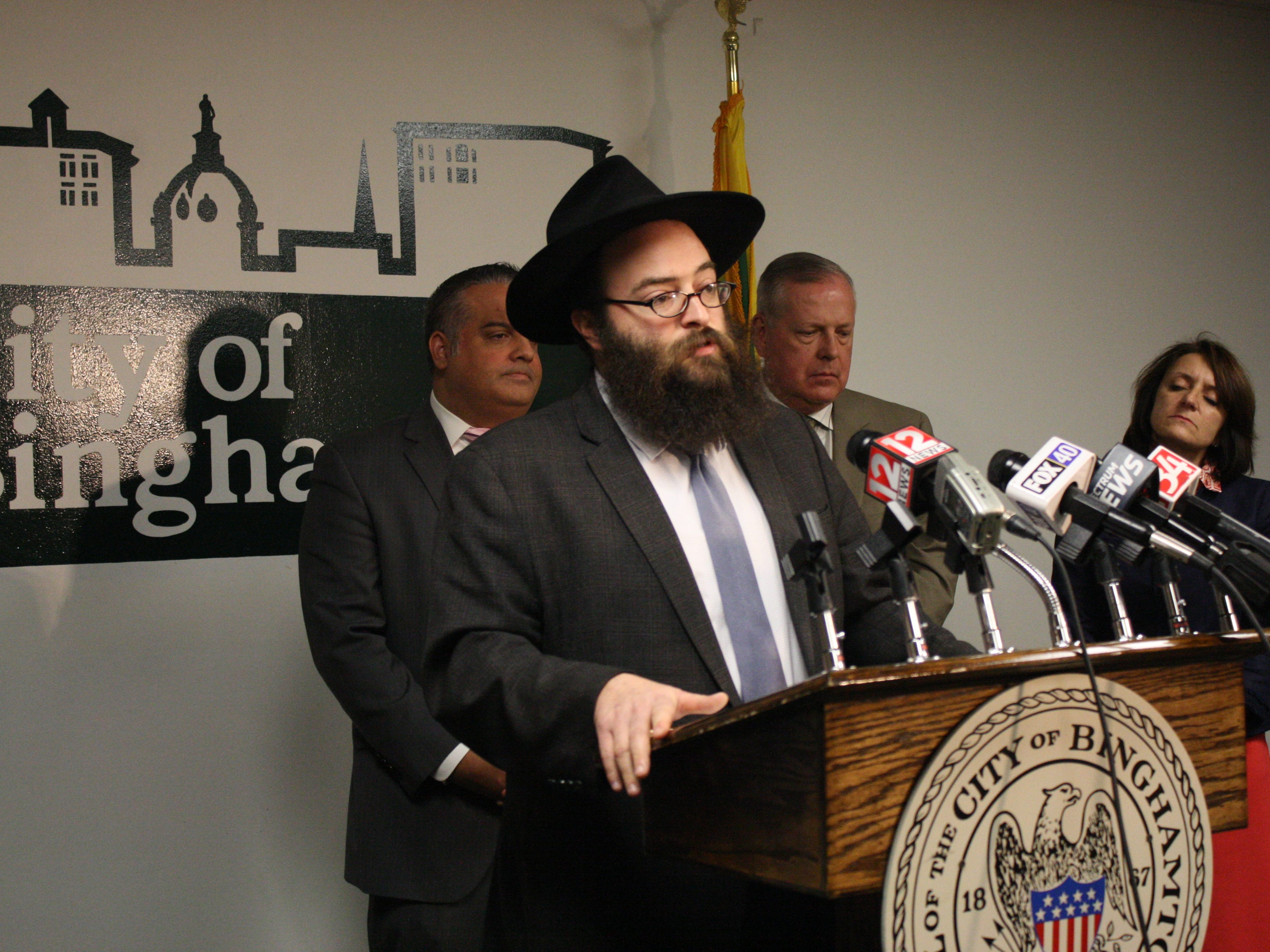 Rabbi Levi Slonim, director of Programming and Development at the Chabad Center for Jewish Student Life at Binghamton University, speaks Wednesday after swastikas were found on and around Binghamton High School Tuesday morning.