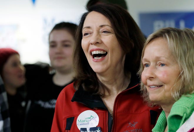 Democratic Sen. Maria Cantwell, left, smiles as she greets supporters during a campaign event Monday in Issaquah, Wash. Cantwell was easily re-elected, defeating former state GOP chairwoman Susan Hutchison.