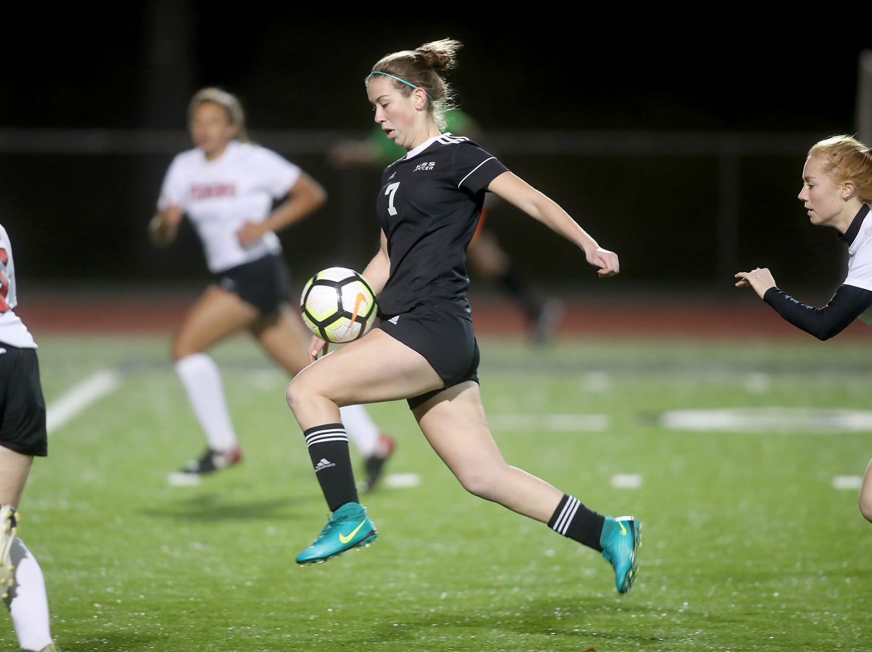 Klahowya player Hope Martin heads down towards the goal keeper as the team defeated Tenino 7-0 in a state soccer game Tuesday, November 6, 2018 at Silverdale Stadium.