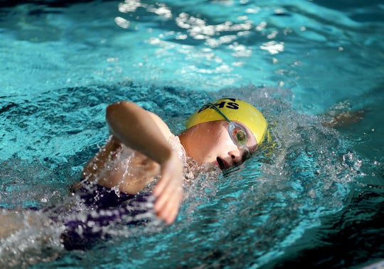 Bainbridge swimming team captain Hannah Lee practices at the Bainbridge Island Aquatics Center on Tuesday. The Spartans will participate in the Class 3A state swimming and diving meet, which begins Friday at the King County Aquatic Center in Federal Way.