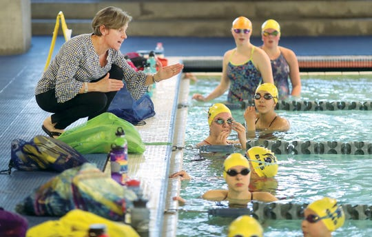 The Bainbridge Island swimming coach Sarah Bullock gives instructions in practice at the Bainbridge Island Aquatics Center on Tuesday. The Spartans are among the contenders at the Class 3A state swimming and diving meet, which begins Friday at the King County  Aquatic Center in Federal Way.