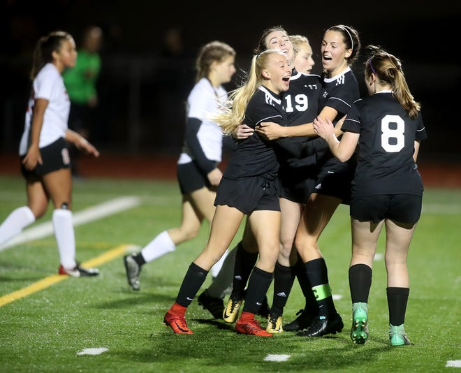 Klahowya players celebrate after scoring a goal as they defeated Tenino 7-0 in a state soccer game Tuesday, November 6, 2018 at Silverdale Stadium.