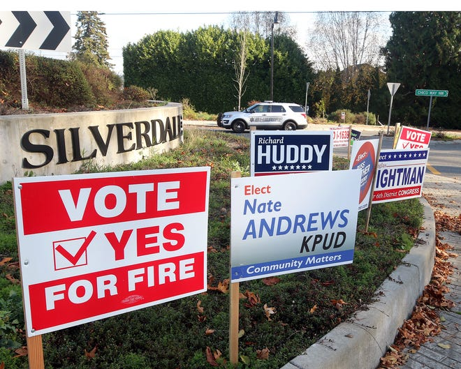 Campaign signs  at the round-about on Silverdale Way and Newberry Hill in Silverdale on Wednesday, November 7, 2018.