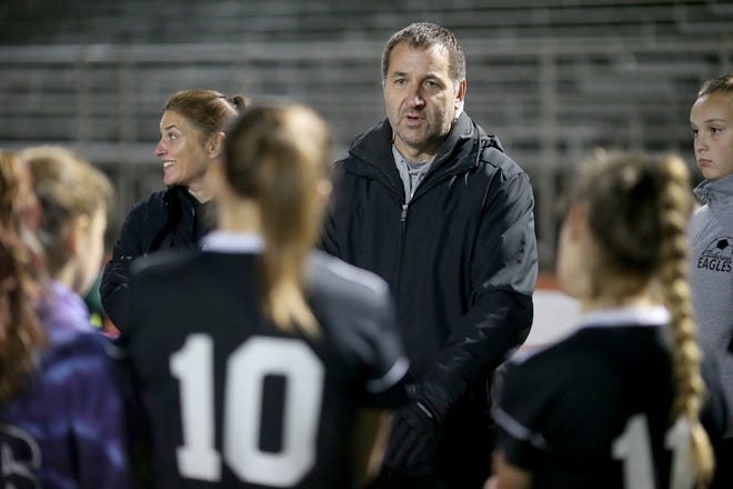 Klahowya girls soccer coach Troy Oelschlager and the Eagles will play in the Class 2A state semifinals after beating Overlake in a shootout Saturday at Silverdale Stadium.