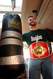 Brock Stodden in 2004, wearing his Canadian-American-Mexican championship belt in the workout room at his Manette home.