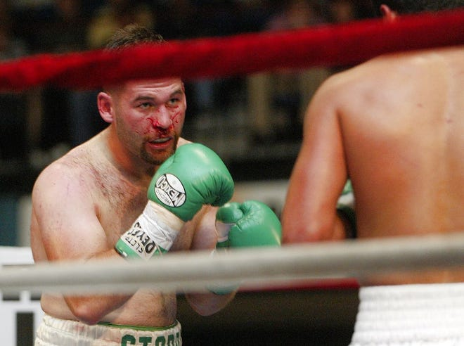 Brock Stodden faces Jose Medina in a 2004 fight at the Kitsap Sun Pavilion. Stodden will be inducted into the Kitsap Sports Hall of Fame on Saturday.