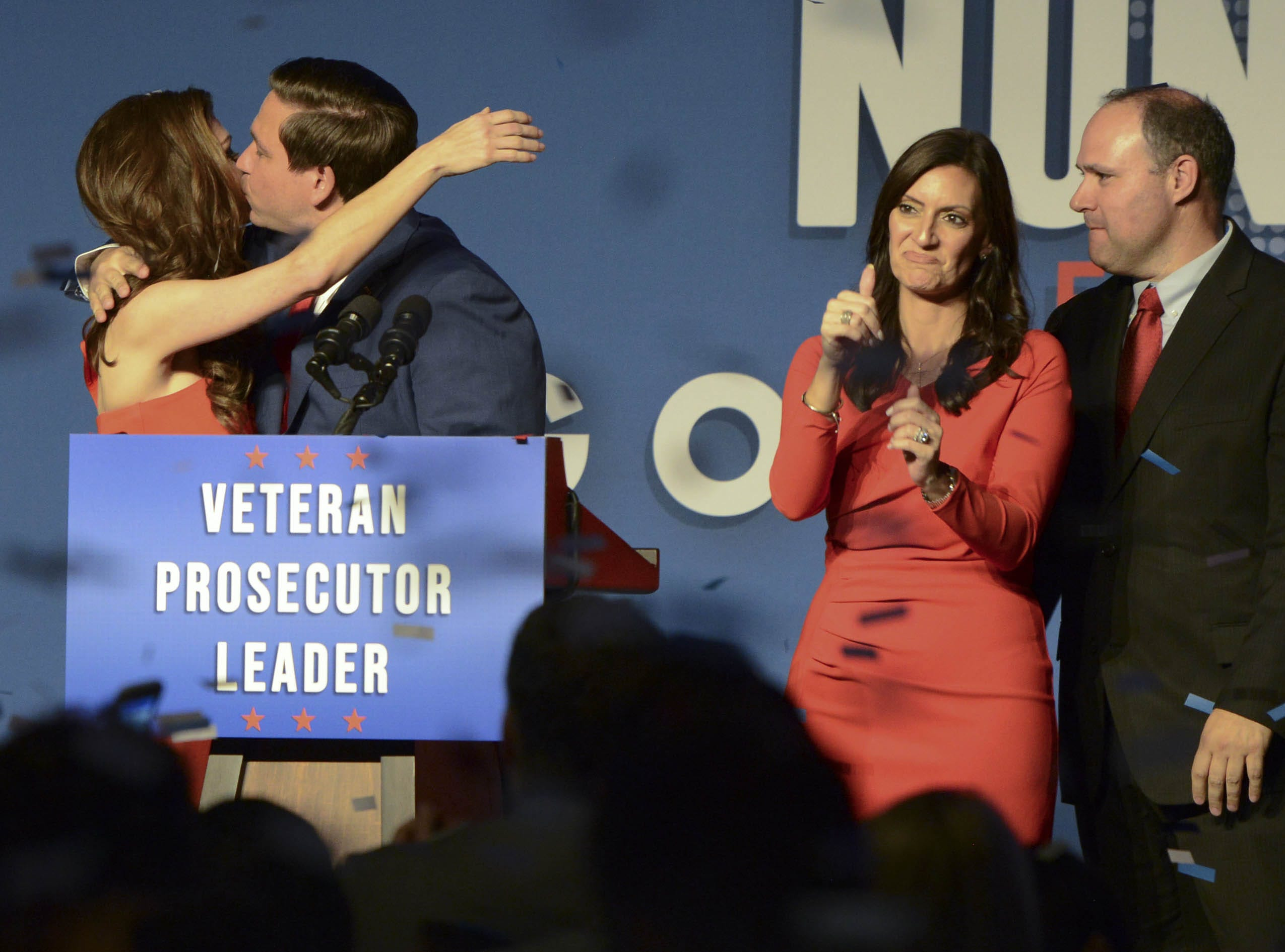 Governor-elect Ron DeSantis kisses his wife, Casey, as Lt. Governor-elect Jeanette Nunez and her husband Adrian watch Tuesday evening.