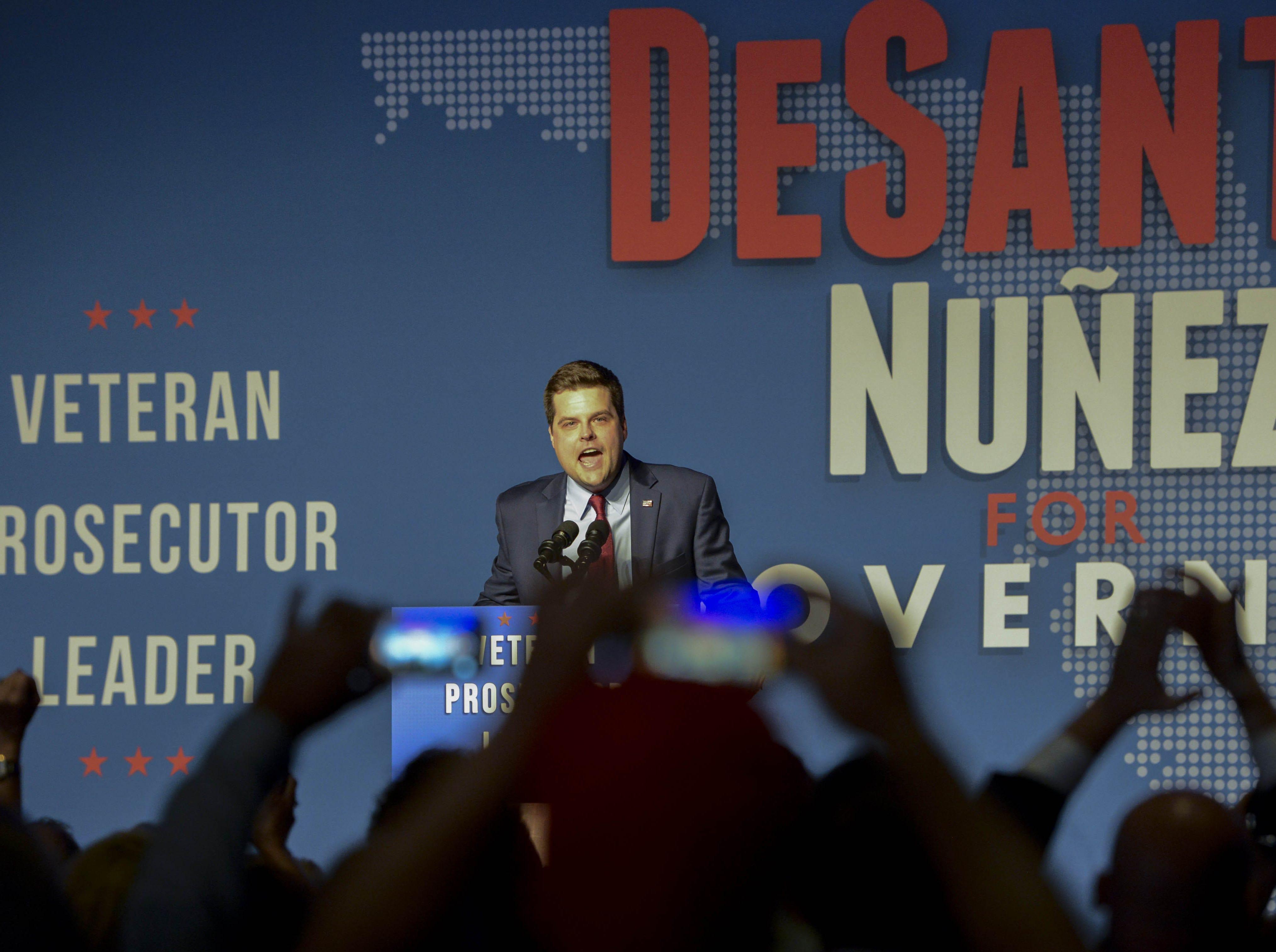 US Rep. Matt Gaetz addresses the crowd waiting for Governor-elect Ron DeSantis Tuesday in Orlando.