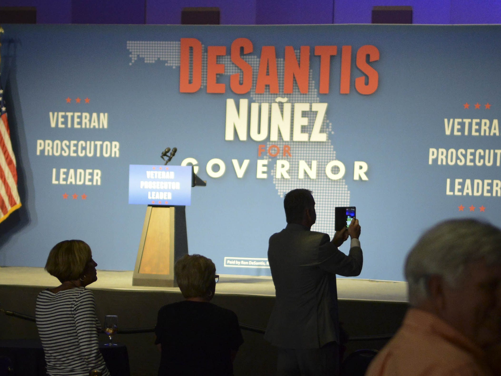 Ron DeSantis supporters take pictures of the stage during the candidate's watch party in Orlando.