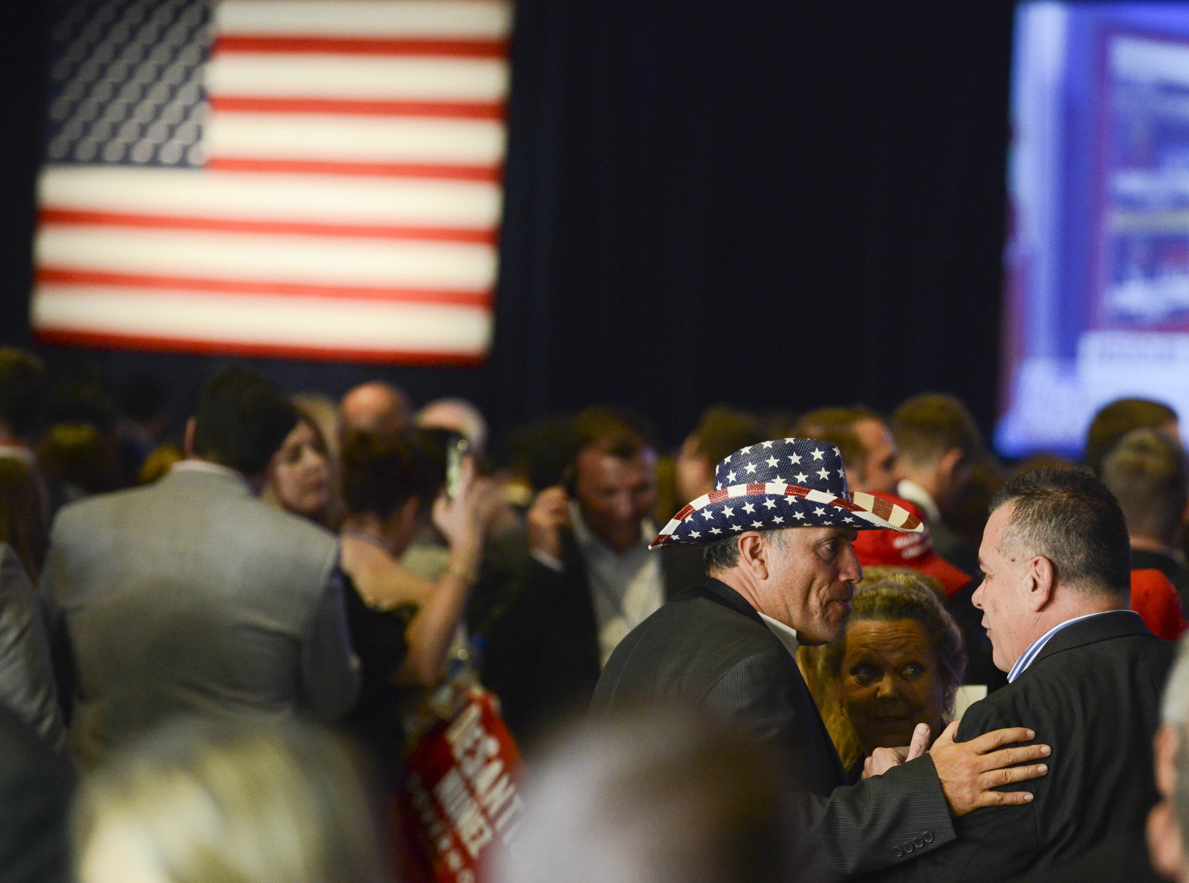 Ron DeSantis supporters hug each other after opponent Andrew Gillis conceded the Florida gubernatorial race.