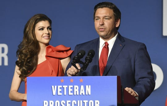 Ron DeSantis and his wife Casey (left) speaks to supporters Tuesday after opponent Andrew Gillum conceded.