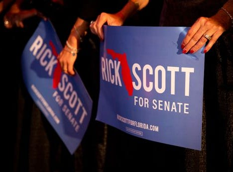 Supporters show their colors at Rick Scott's election watch party in Naples.