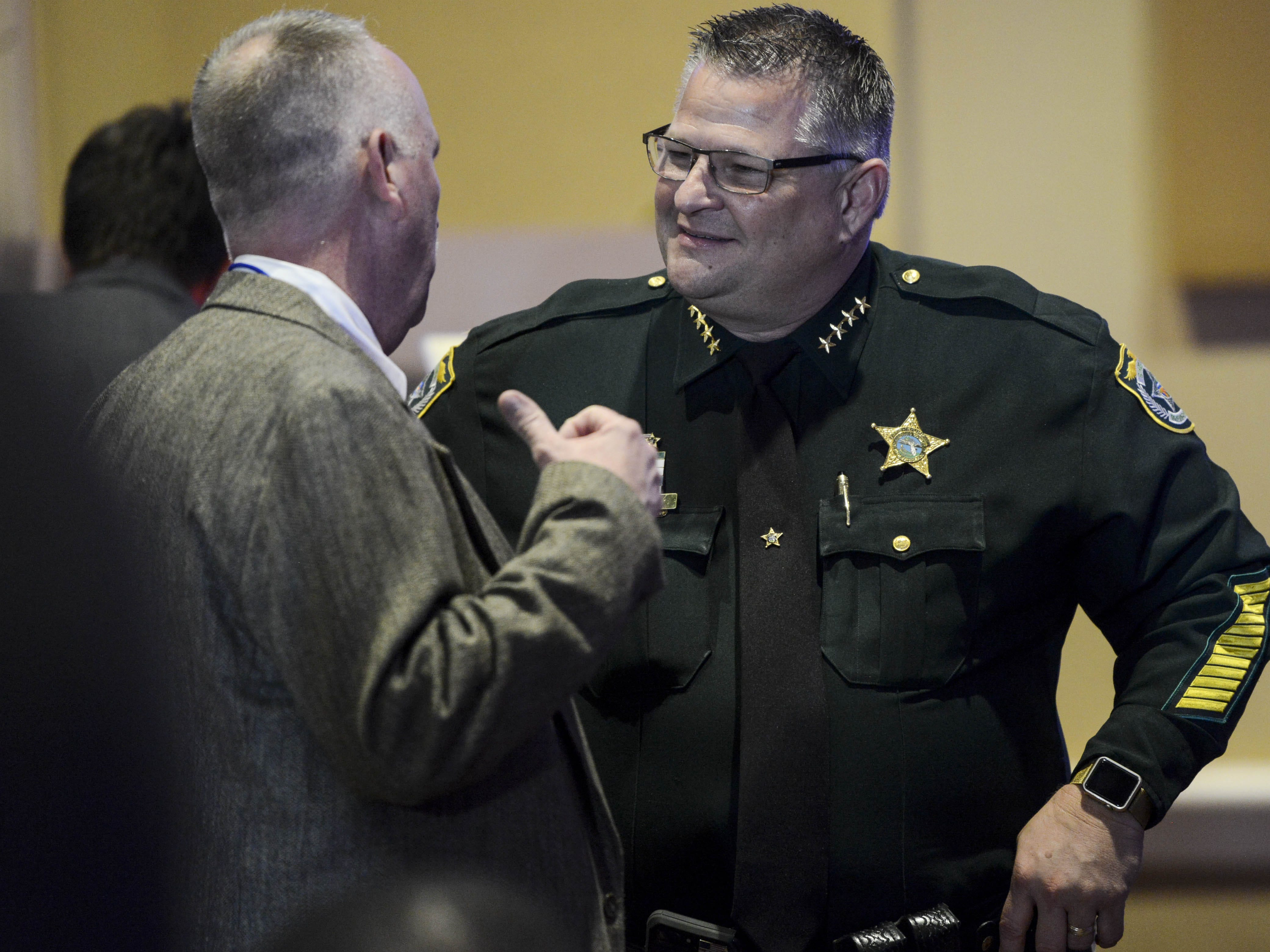 Brevard County Sheriff Wayne Ivey talks with others attending the  Ron DeSantis watch party at The Rosen Centre Hotel.