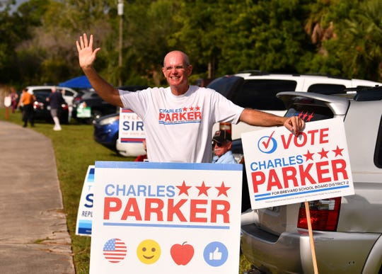 School board candidate Charles Parker greeting voters in Rockledge.