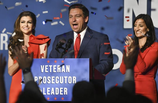 Ron DeSantis, his wife Casey (left) and Lt. Governor-elect Jeanette Nunez wave to supporters in Orlando the day after his election victory.