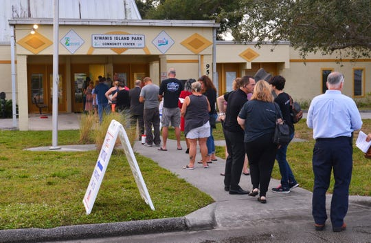Voters lined up at the door at 7 a.m. Election Day at Kiwanis Island Park Community Center on Merritt Island as the polls opened.