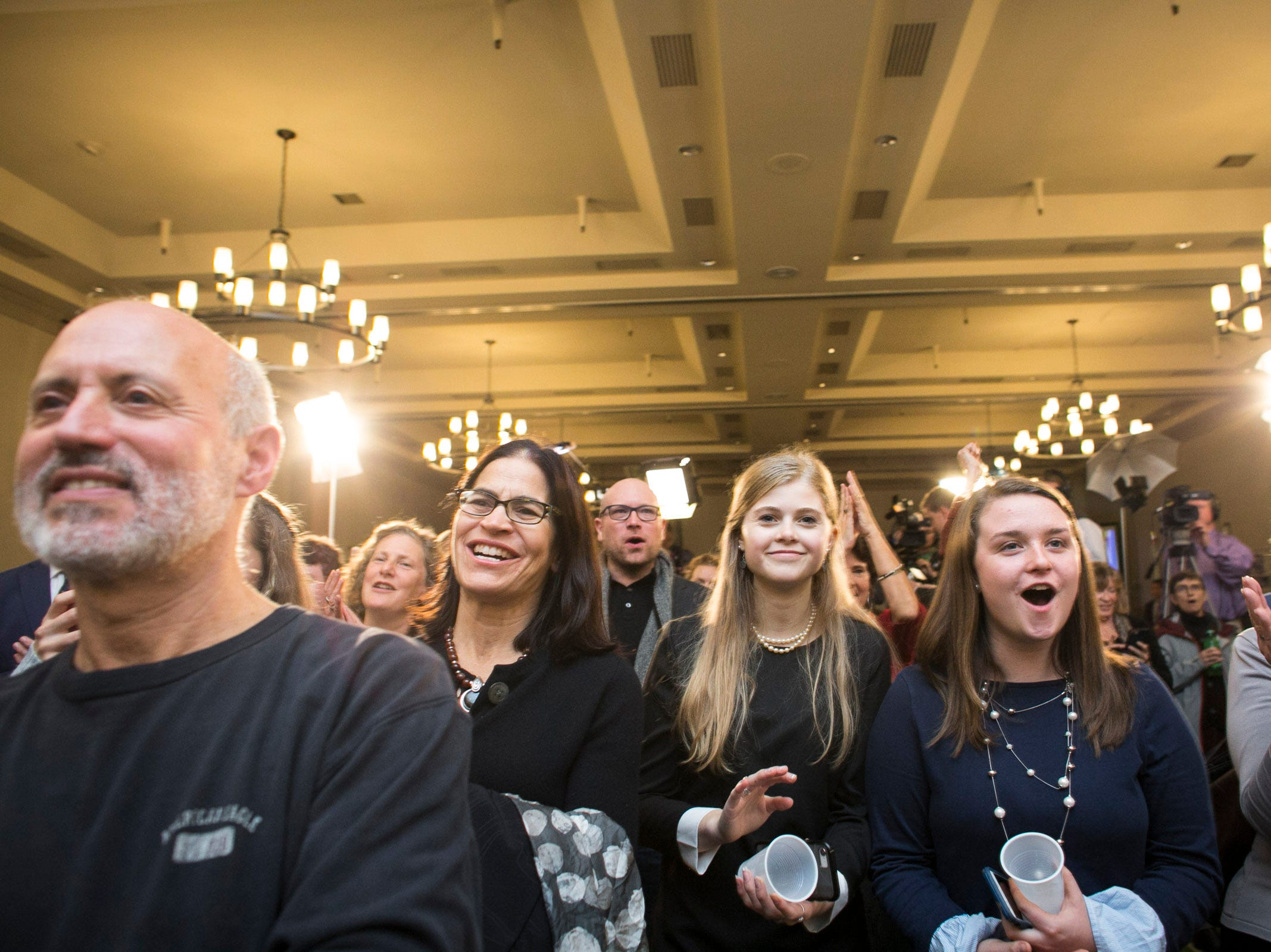 Onlookers cheer as Sen. Patrick Leahy takes the stage at the Hilton in Burlington, Vermont on Tuesday, November 6, 2018.