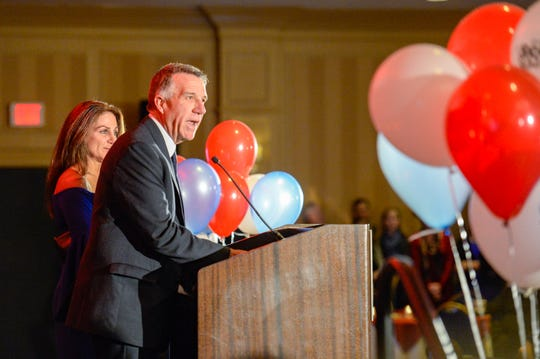 Gov. Phil Scott celebrates his win Tuesday night at the Double Tree by Hilton in Burlington, defeating democratic challenger Christine Hallquist.
