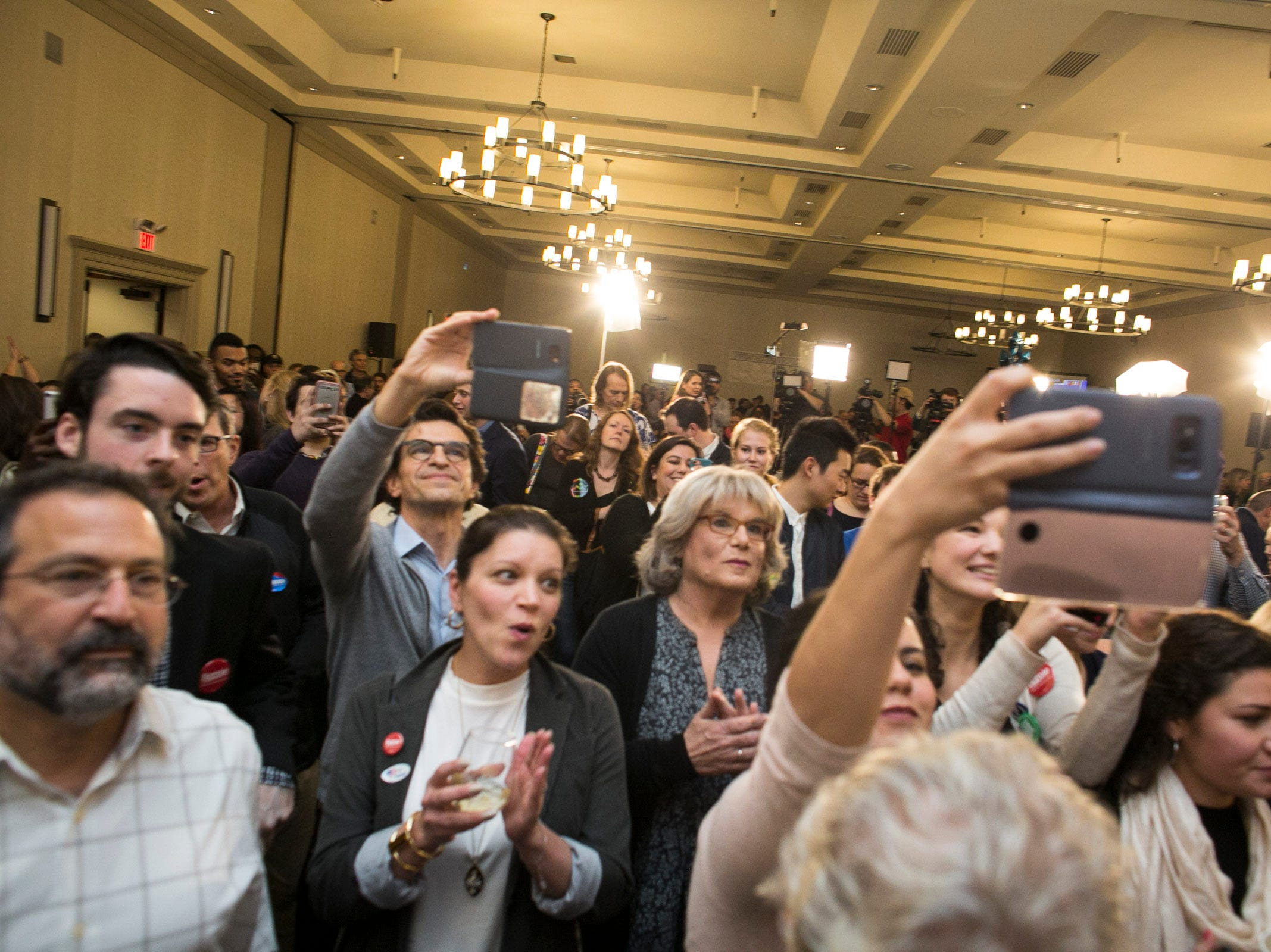 Onlookers cheer for Sen. Bernie Sanders at the Hilton in Burlington, Vermont on Tuesday, November 6, 2018.