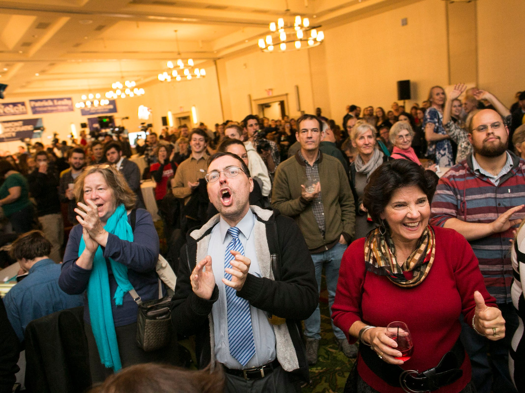 Onlookers cheer as national midterm election results come in at the Hilton in Burlington, Vermont on Tuesday, November 6, 2018.