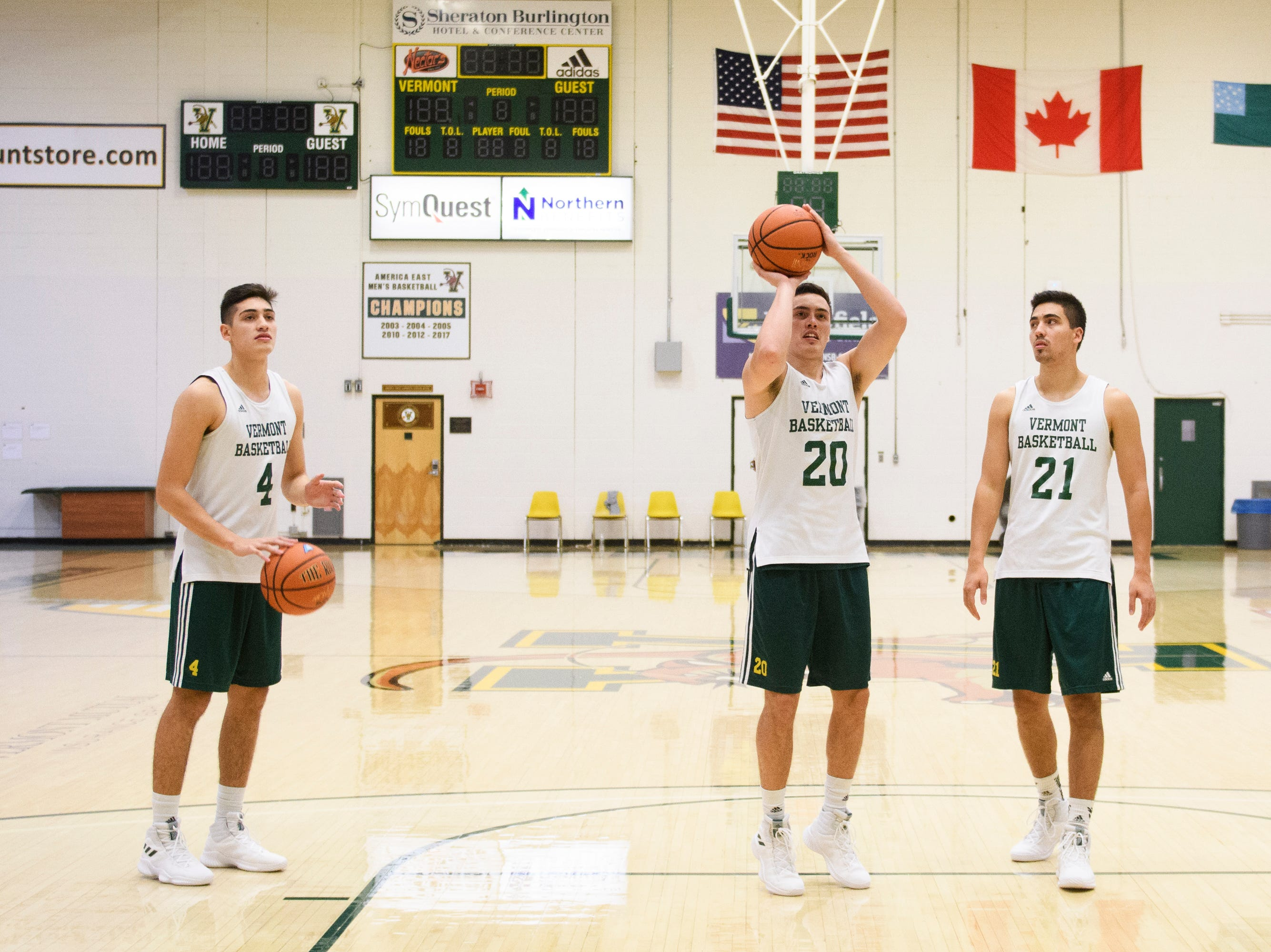 Robin Duncan, left, Ernie Duncan and Everett Duncan shoot around at Patrick Gymnasium last month. The trio is poised to make the University of Vermont men's basketball team just the fourth ever in Division I to feature three brothers at the same time.