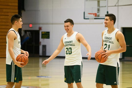 Robin Duncan, left, Ernie Duncan and Everett Duncan shoot around at Patrick Gymnasium last month. The trio is poised to make the University of Vemront men's basketball team just the fourth ever in Division I to feature three bothers at the same time.