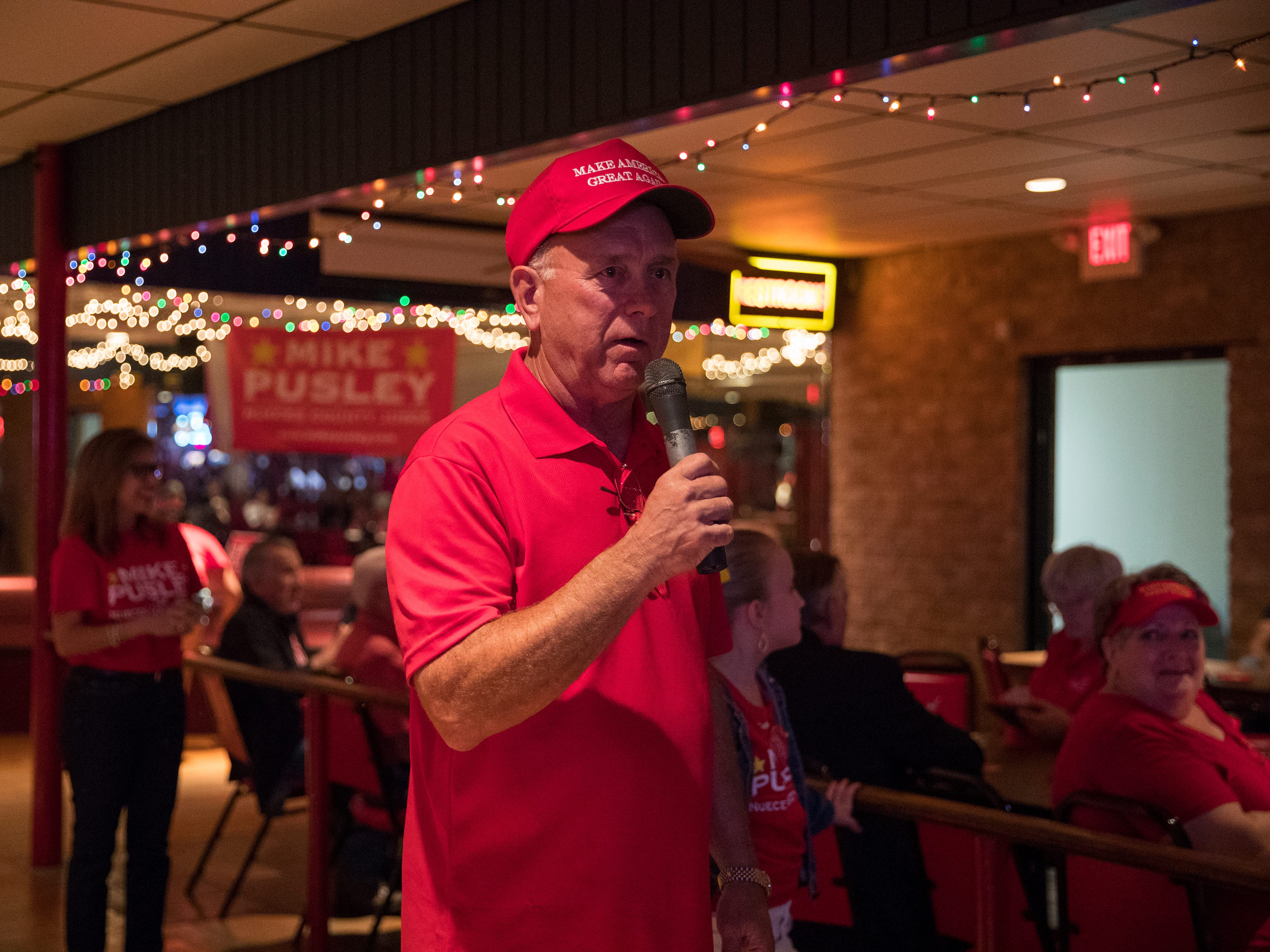 Republican candidate for Nueces County Judge Mike Pusley talks with supporters during his watch party at the Bar-B-Q Man on Tuesday, November 6, 2018.