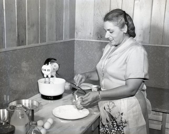 "Mrs. Sam Susser begins preparations for one of the many cakes contained in the ""Cooking Gems"" cookbook in June 1951. The cookbook was sold by the Temple Beth El Sisterhood to raise funds for a new temple kitchen."