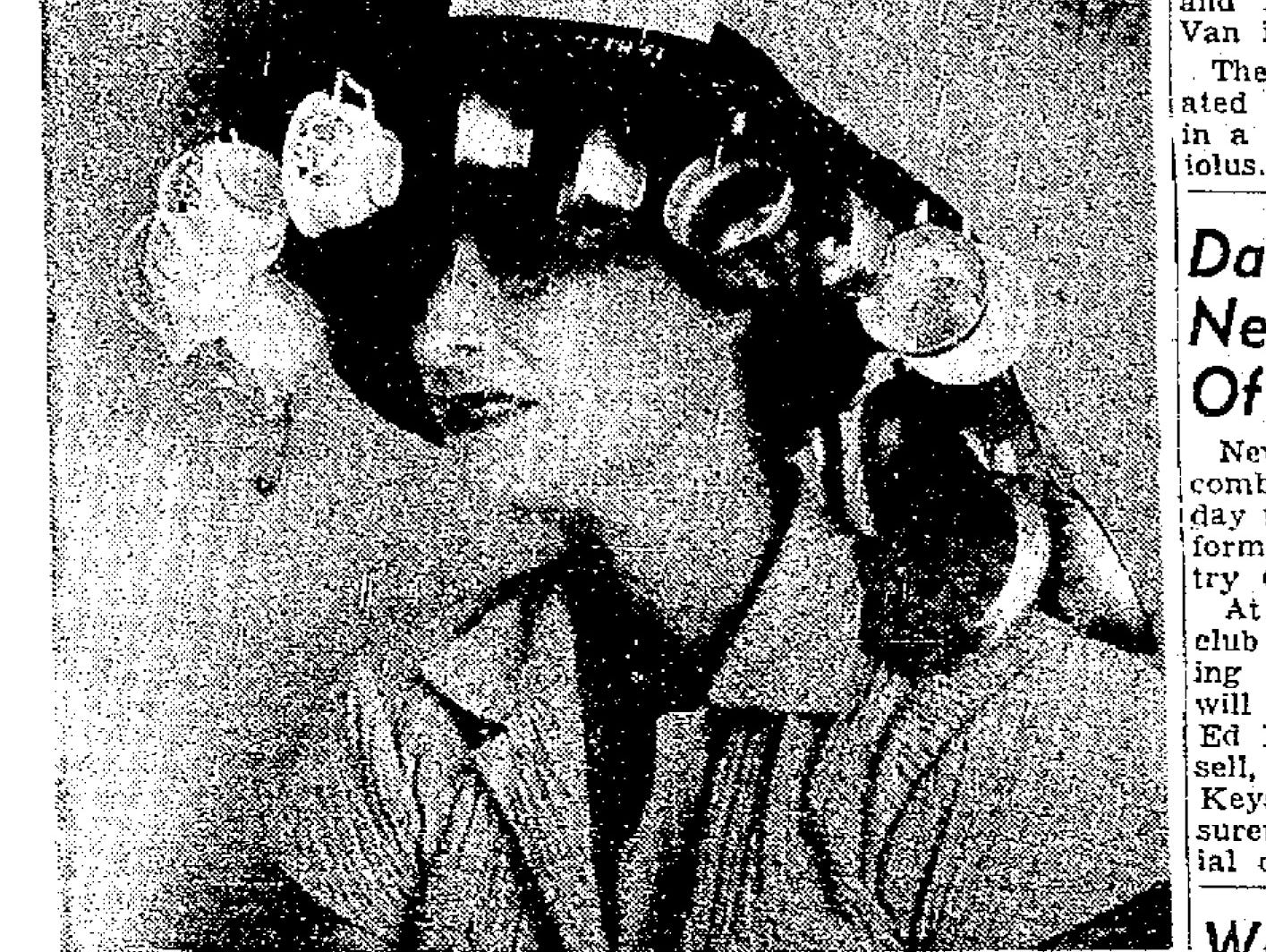 The Temple Beth El Sisterhood cookbook was incorporated into the winning hat design at a luncheon held by the Sisterheer. Mrs. Sidney Wolf, wife of Rabbi Sidney Wolf, designed and modeled the hat.