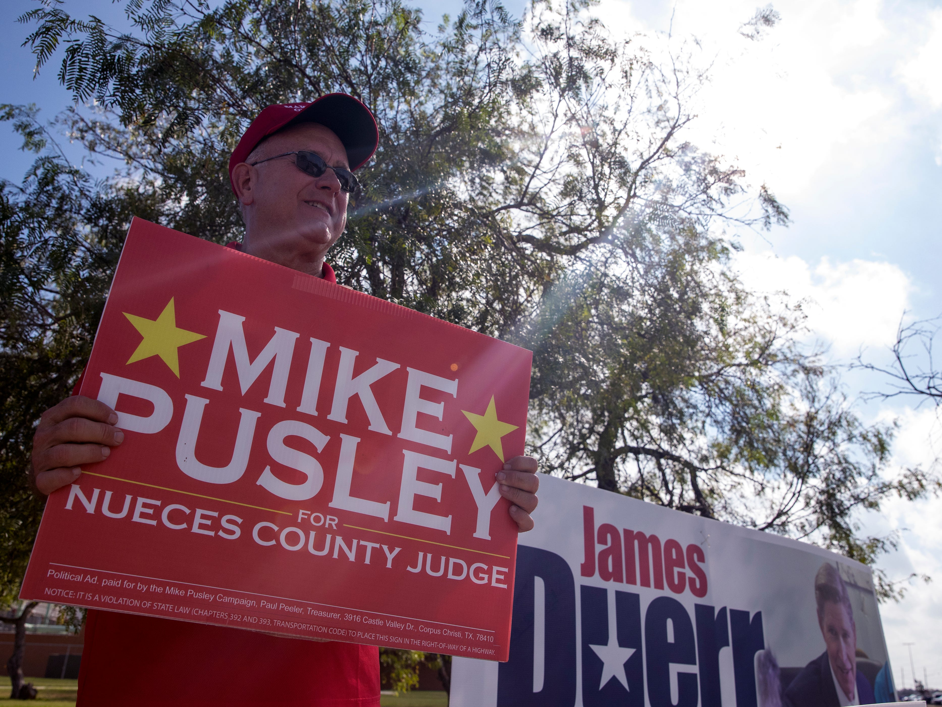 Republican candidate for Nueces County Judge Mike Pusley campaigns outside Veterans Memorial High School onTuesday, November 6, 2018.